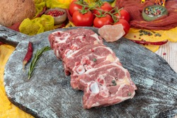 Raw fresh meat lamb, lamb neck (Lamb Gerdan) isolated on black ground. Copy space for Text. sirloin on bone neck.
