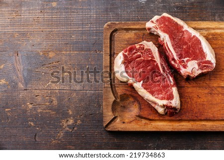 Raw fresh meat Ribeye Steak on dark background #219734863
