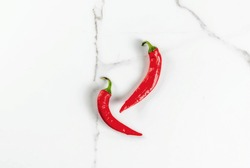 Raw fresh organic chili pepper on white marble background top view copy space