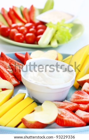 Raw  fruits and vegetables with cream cheese and yogurt dip