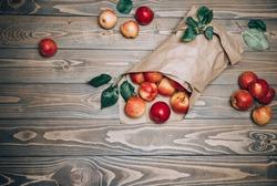 Raw Fruits. Fresh Apple Fruit. Garden Red Apples in Paper Cornet on Rustic Dark Brown Wood Table. Copy Space