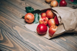 Raw Fruits. Fresh Apple Fruit. Garden Red Apples in Paper Cornet on Rustic Dark Brown Wood Table