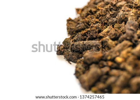 raw granulated tea so close isolated on white