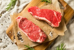Raw Grass Fed NY Strip Steaks with Salt and Pepper