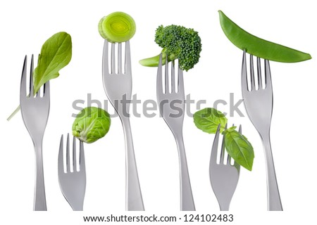 raw green food on forks isolated against white background