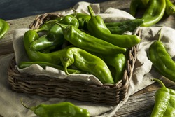 Raw Green Spicy Hatch Peppers in a Basket
