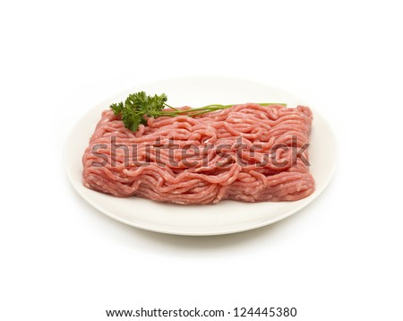 Raw ground beef on a plate, sitting on a white background. - stock photo