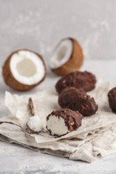Raw homemade vegan chocolate coconut dessert bounty. Healthy vegan food concept.