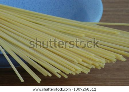 raw italian long spaghetti in blue plate  #1309268512