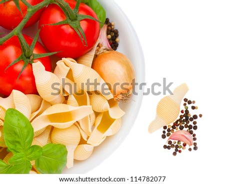 raw italian pasta ingredients in plate isolated on white background
