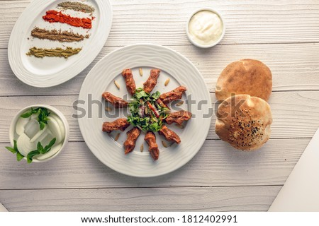 raw kabab and bread with spices Foto stock ©