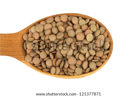 Raw lentils in wooden spoon isolated on white (clipping path)