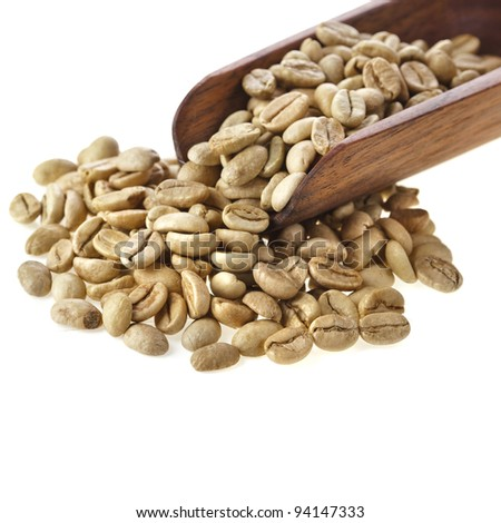 raw live coffee beans in a spoon Isolated on white background