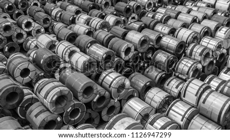 Raw material Handling: Steel coil storing inside a warehouse for exporting to automotive industry plant in black and white. #1126947299