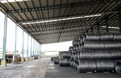 Raw material of steel wire in starage, high carbon steel wire, Black carbon wire rode business, Steel roll are loading from ship