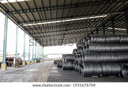 Raw material of steel wire in starage, high carbon steel wire, Black carbon wire rode business, Steel roll are loading from ship Stock fotó ©