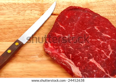 raw meat and knife on cutting board stock photo 24452638 shutterstock. Black Bedroom Furniture Sets. Home Design Ideas
