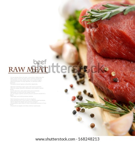 raw meat and vegetables on a white background