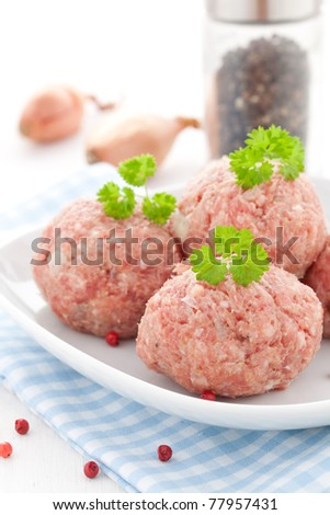 raw meat balls on a plate