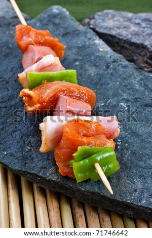 Raw meat on a skewer ready for grill