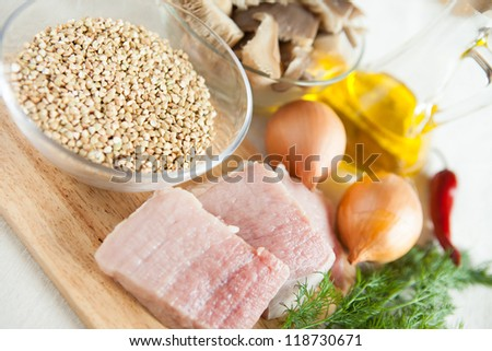 Raw meat, onions, mushrooms - ingredients for garnish, close up