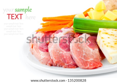 raw meat with fresh vegetables isolated on white background