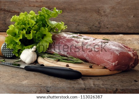 raw meat with  lettuce and porcelain mortar