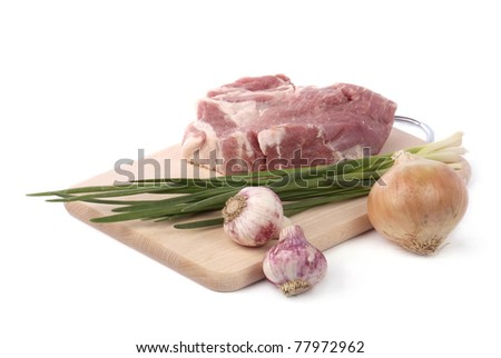 raw meat with onion and garlic isolated on white background