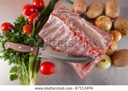 Raw meat with vegetables and herbs