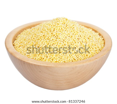 raw millet in bowl isolated