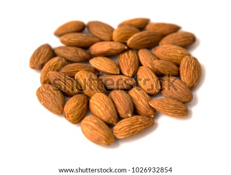 Raw Natural Organic Almonds Nuts Scattered Isolated on White Background Top View Healthy Food for Life Natural Light Selective Focus #1026932854