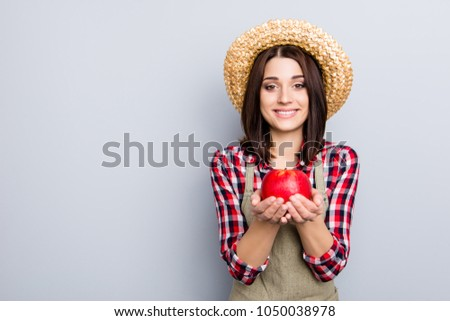 Raw non-gmo gmo-free ideal give people person concept. Portrait of glad cute excited female gardener showing holding in hands eating presenting yummy tasty apple isolated on gray background #1050038978