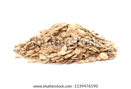 Raw oatmeal on white background. Healthy grains and cereals #1139476190
