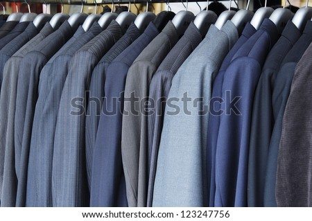 Raw of different colors man's jackets hanging - stock photo
