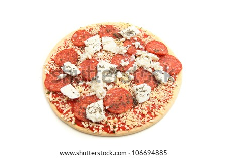 Raw or uncooked Salami Pizza Isolated on white