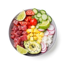 Raw organic ahi tuna poke bowl with rice and veggies. top view . isolated on white background