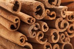 Raw Organic Cinnamon sticks (Cinnamomum verum).Macro closeup background texture. Front side view.
