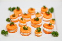 Raw Organic Food. Small Carrot Sandwich Bites With Creamy Vegan Stuffing And Parsley On Top. Close-up, served food, isolated on white background.