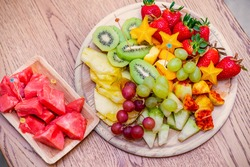 Raw Organic Fruit Platter With Berries, Melons, Kiwi, Mango, Pineapple, Carambola, Watermelon, Prickly Pear, Strawberry On The Wooden Board, On The Table, Top View, Selective Focus.