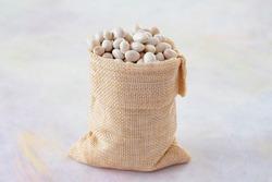 Raw Organic White Haricot bean on white background