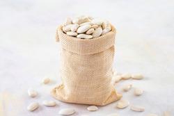 Raw Organic White Haricot bean on white background.