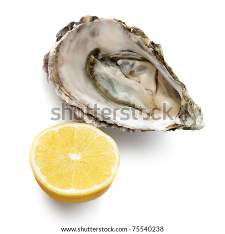 Raw oyster and half of lemon