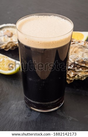 Raw Oyster and Stout with a Lemon Wedge, an Irish Cuisine Speciality Stock photo ©