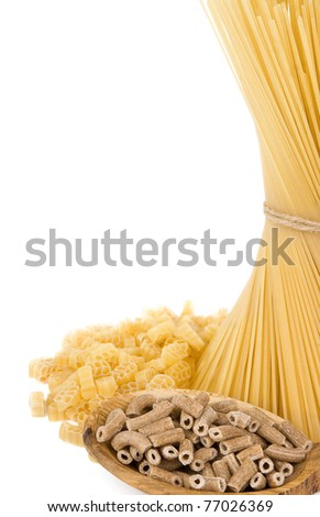 raw pasta and wooden spoon isolated on white background