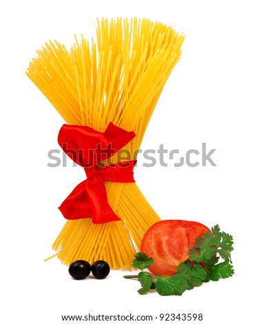 Raw pasta with red ribbon and tomato isolated on white