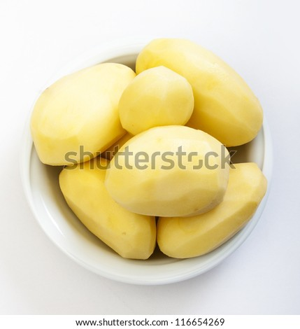 Raw peeled potatoes isolated on a white background