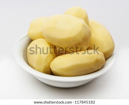 Raw peeled potatoes isolated on a white background