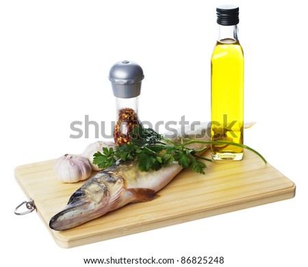 Raw pike with cooking ingredients isolated on white background