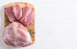 Raw pork meat . Shoulder and fillet on wooden background
