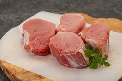 Raw pork medallion served rosemary for cooking